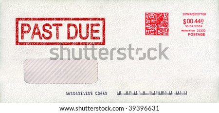 Past due envelope with postage - stock photo