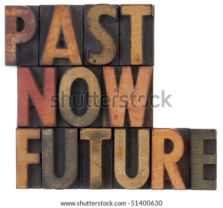 past, now, future words in vintage wooden letterpress block types, stained in color ink, isolated on white - stock photo
