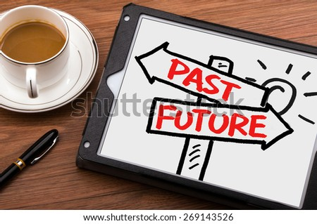 past or future on signpost concept hand drawing on tablet pc - stock photo