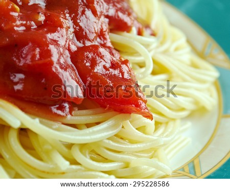 Pasta al pomodoro -  Italian food typically prepared with pasta, olive oil, fresh tomatoes, basil