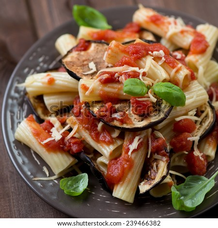 Pasta alla Norma: typical italian dish with eggplant and tomato - stock photo