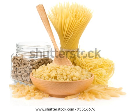 pasta and wooden spoon isolated on white background - stock photo