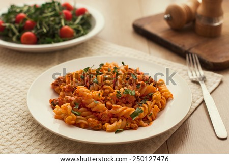 pasta bolognese tomato beef sauce on the kitchen table - stock photo