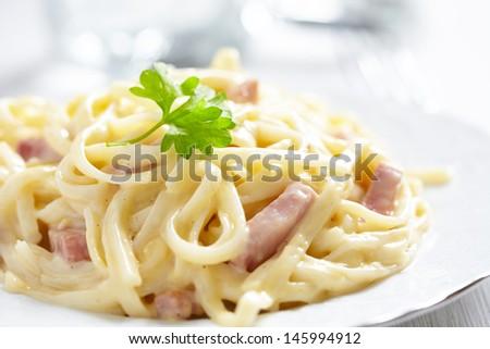 Pasta Carbonara with ham and cheese - stock photo