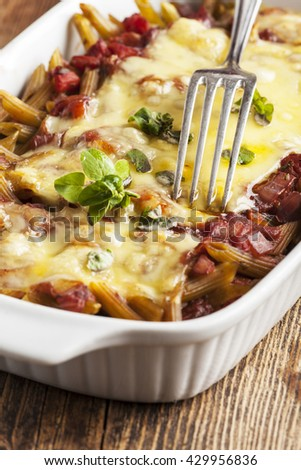 pasta casserole on dark wood