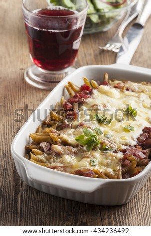 pasta casserole on dark wood  - stock photo