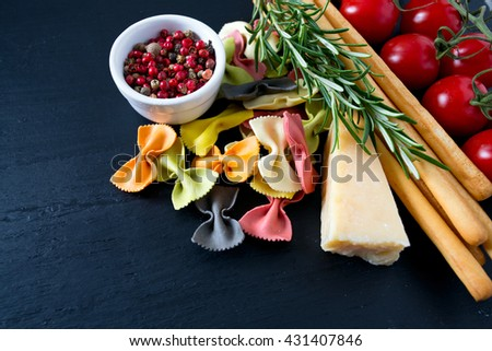 pasta, cheese, bread and tomatoes - stock photo