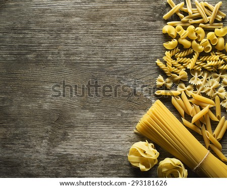 Pasta collection on rustic wooden background - stock photo