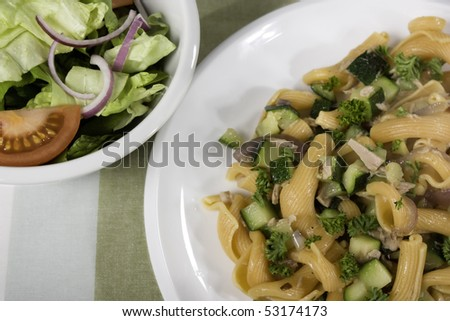 Pasta dinner with side salad
