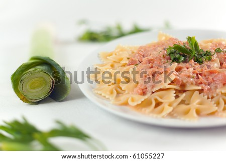 Pasta Farfalle with smoked Salmon, fresh cream, leeks and brandy - stock photo