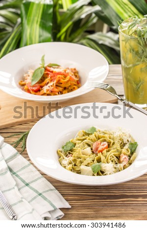 Pasta fettuccine with lemonade on wooden table - stock photo