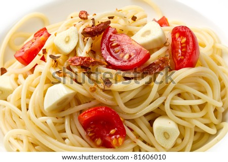pasta garlic olive oil and red chili pepper closeup on a white dish - stock photo