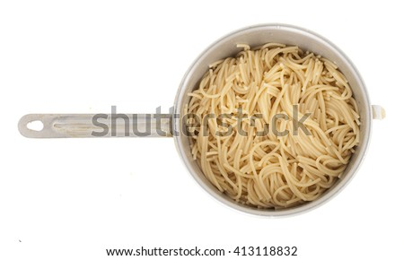 Pasta in a colander on a white background - stock photo