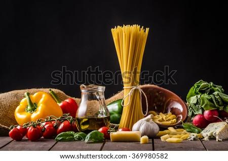 Pasta ingredience on black background - stock photo