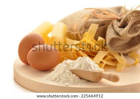 Pasta ingredients assortment isolated on white background - stock photo