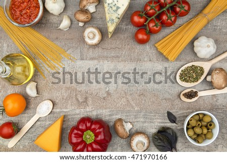 Pasta ingredients on the wooden board, frame background with free space for a text
