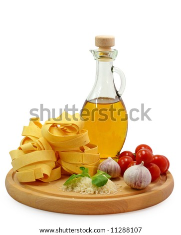 pasta ingredients on wooden board - stock photo