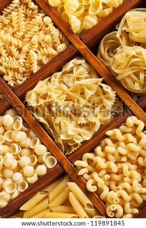 Pasta mix in compartment wooden box - closeup