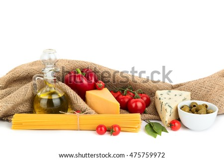Pasta, olive oil, cheese and vegetables with rustic sackcloth on white background with copy space for the text