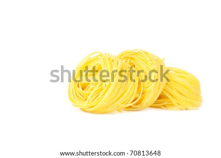 Pasta on a white background, a shot horizontal, focus on the image middle. - stock photo
