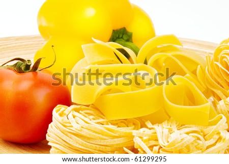 Pasta, paprika and tomato on plate - stock photo