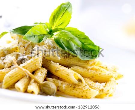 Pasta. Penne Pasta with Pesto Sauce. Italian Cuisine - stock photo