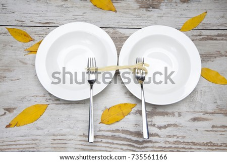 pasta rolled on fork, food sharing or hunger concept