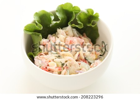 Pasta salad  Fusilli and Japanese kamaboko on white background with copy space