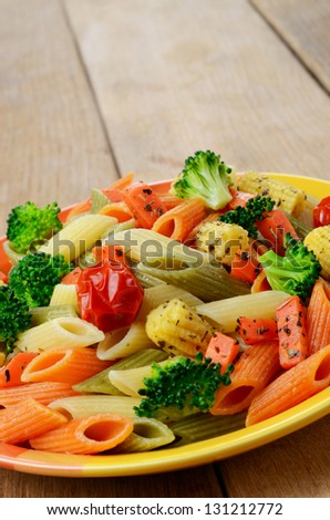 Pasta salad with broccoli carrot corn and tomatoes