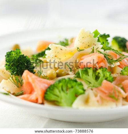Pasta salad with smoked salmon and broccoli - stock photo