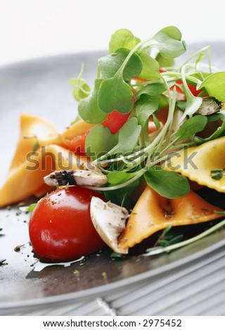 pasta salad with tomato,rocca,mushrooms,herbs
