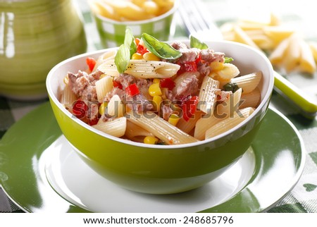 pasta salad with tuna and corn in green bowl - stock photo