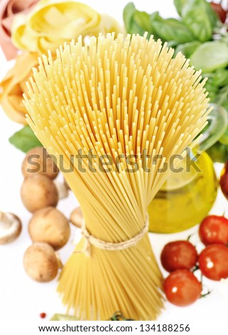 Pasta spaghetti, vegetables and spices, on a white background - stock photo