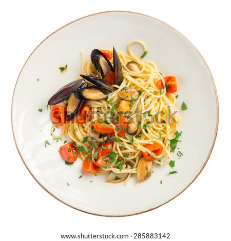 Pasta spaghetti with mussel and tomatoes isolated on white background - stock photo