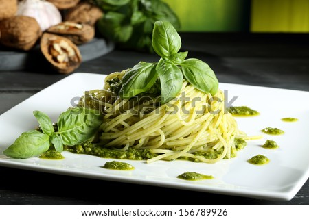 pasta spaghetti with pesto  green background - stock photo