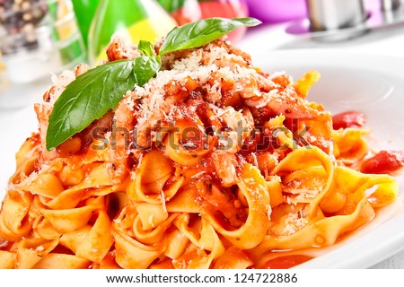 Pasta tagliatelle with tomato - stock photo