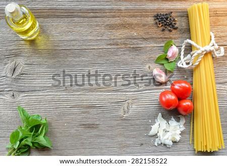 Pasta tomato parmesan on a wood background - stock photo