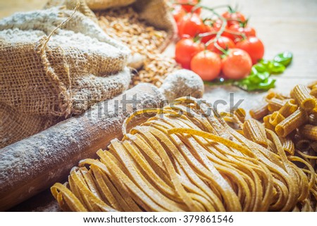 Pasta tubes and tagliatelle with integral flour. - stock photo