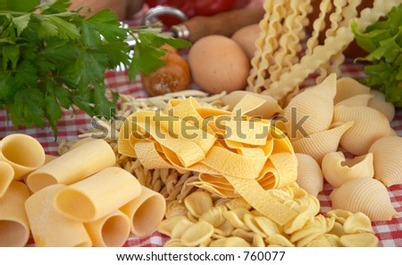Pasta, vegetables, egg, basic ingredients of Italian and Mediterranean food - stock photo