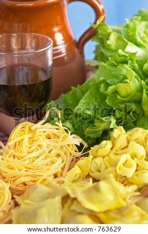 Pasta, vegetables, egg, wine, typical ingredients of Italian and Mediterranean food - stock photo