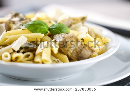 Pasta with artichokes - stock photo
