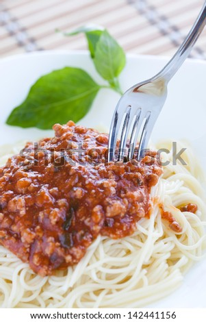 Pasta With Bolognese Ragu On White Plate. - stock photo