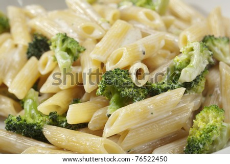 pasta with broccoli in creamy sauce - stock photo