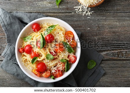 pasta with cheese and tomato on wood, food above