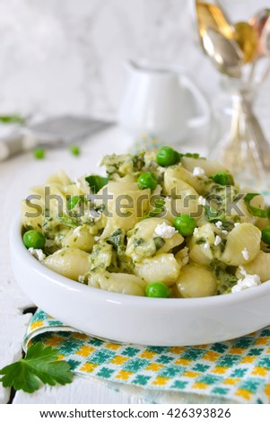 pasta with cheese, spinach and green peas  - stock photo