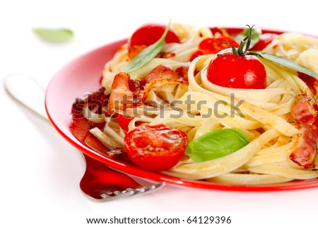 Pasta with cherry tomato and bacon on white isolated background - stock photo