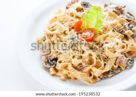 Pasta with chicken and mushrooms, lettuce and tomato - stock photo