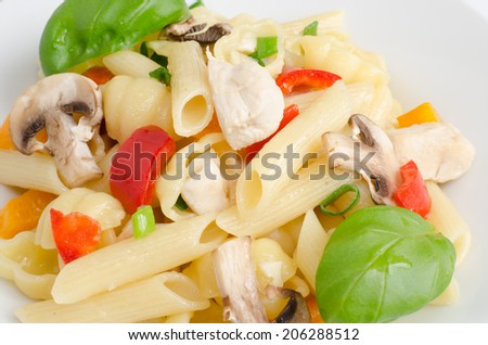 Pasta with chicken, basil and paprica red, yellow - stock photo