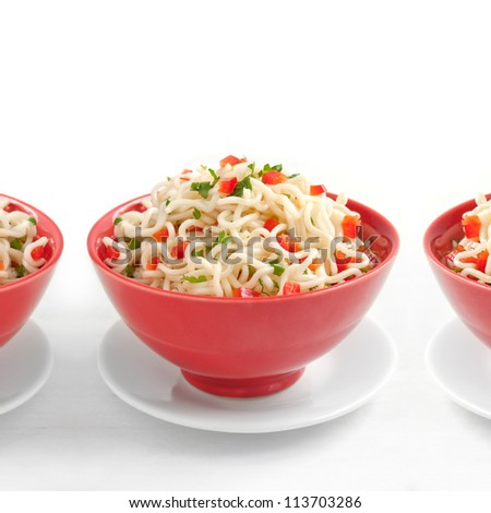 Pasta with chopped red pepper and herbs - stock photo
