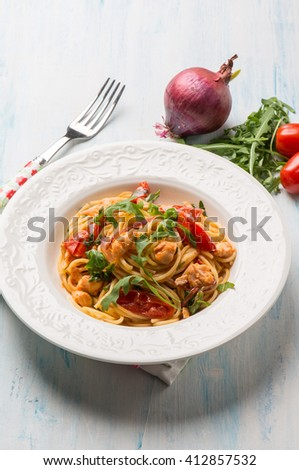 pasta with fresh salmon tomatoes and arugula - stock photo
